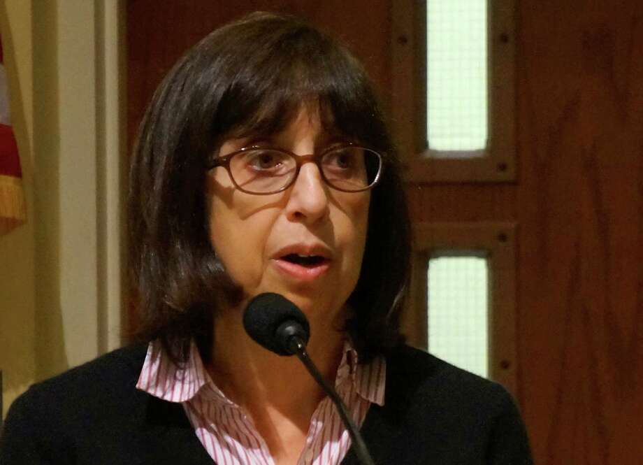 Selectman Shelly Kassen, at Tuesday's Representative Town Meeting session, talks about possible renegotiation of a proposal to build a senior residential campus on the Baron's South property.  Westport CT 11/13/12 Photo: Paul Schott / Westport News