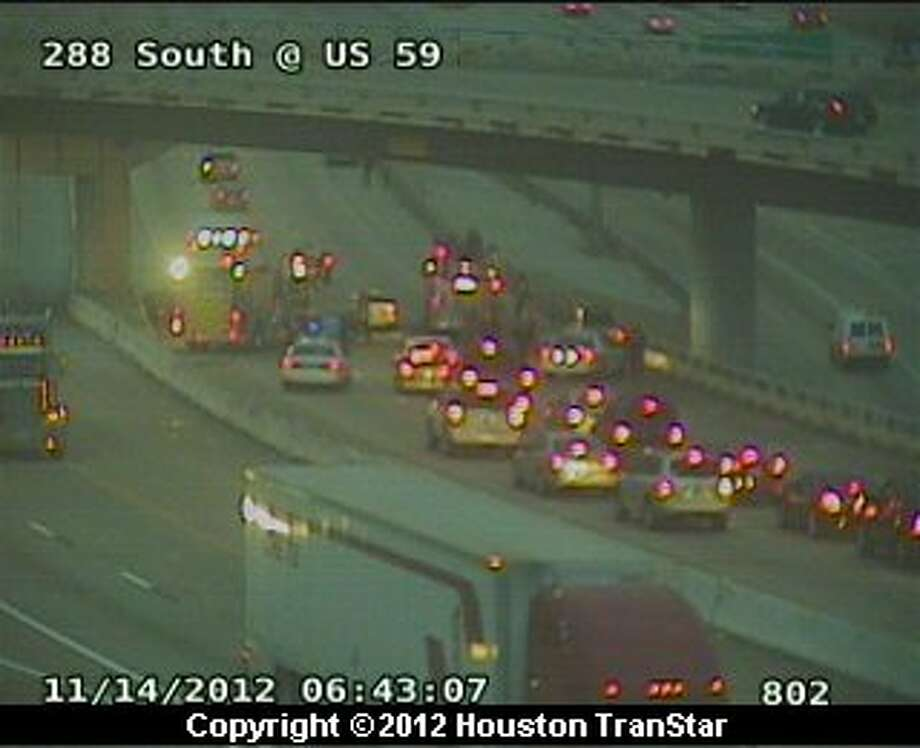 Traffic was snarled on Texas 288 near U.S. 59 after a wreck early Wednesday morning. Photo: Houston Transtar