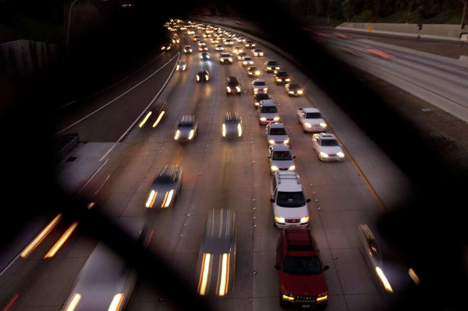 FILE - In this Tuesday, Nov. 22, 2011, file photo, cars fill the highway two days before Thanksgiving, in San Diego. The number of Americans hitting the road for Thanksgiving in 2012, is expected to increase slightly from a year ago, according to AAA's annual Thanksgiving travel forecast released Tuesday, Nov. 13, 2012. But they'll take shorter trips to save on gas and other costs as household budgets remain tight. (AP Photo/Gregory Bull, File) Photo: Gregory Bull