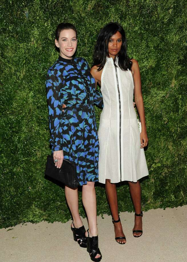 Actress Liv Tyler, left, and model Liya Kebede attend the 2012 CFDA / Vogue Fashion Fund Awards on Tuesday Nov. 13, 2012 in New York. Photo: Evan Agostini, Evan Agostini/Invision/AP / Invision