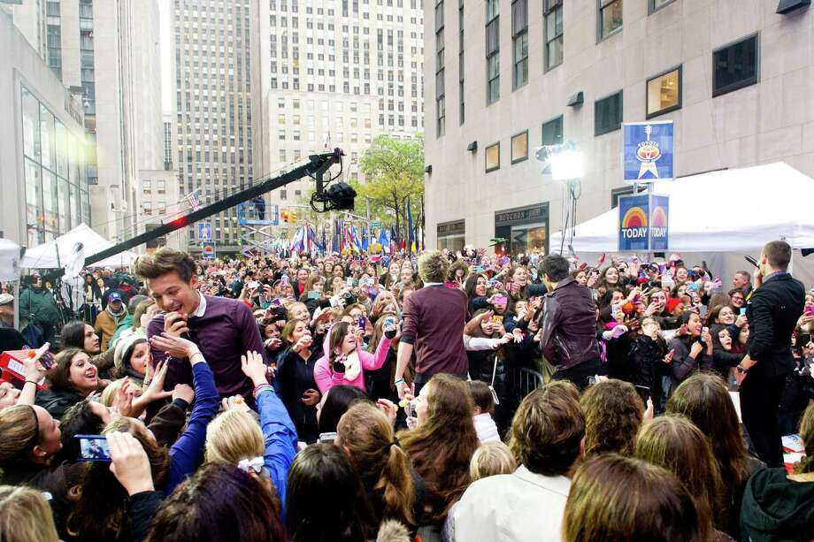"One Direction member Louis Tomlinson, left, performs on NBC's ""Today"" show on Tuesday, Nov. 13, 2012 in New York. Photo: Charles Sykes, Charles Sykes/Invision/AP / Invision"