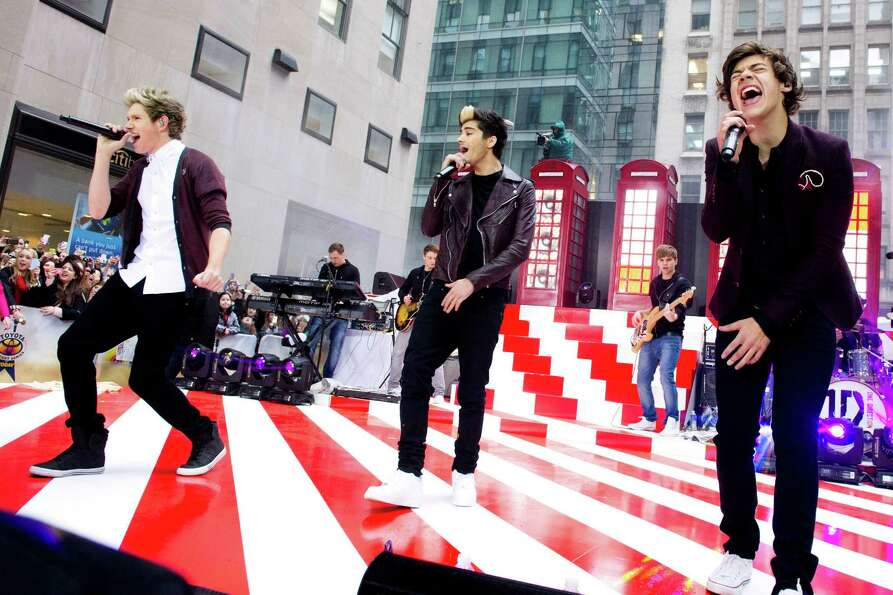 One Direction members, from left, Niall Horan, Zayn Malik and Harry Styles perform on NBC's
