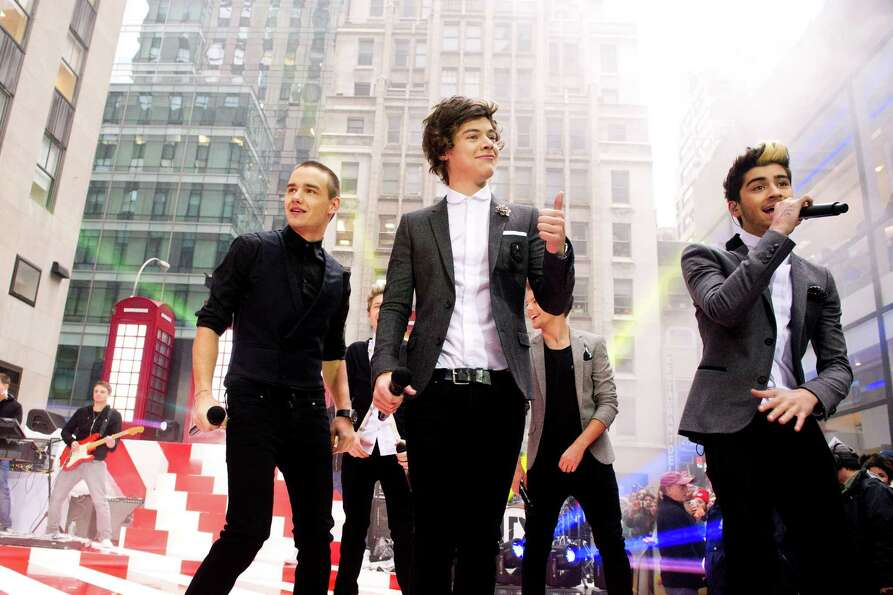 One Direction members, from left, Liam Payne, Harry Styles and Zayn Malik perform on NBC's