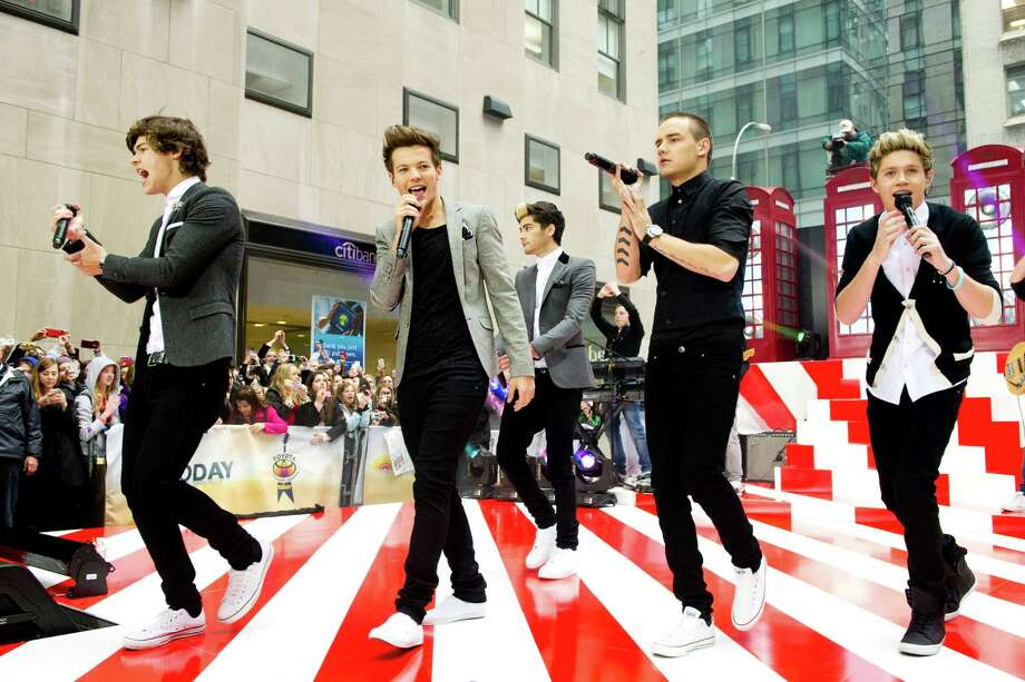 "One Direction members, from left, Harry Styles, Louis Tomlinson, Zayn Malik, Liam Payne and Niall Horan perform on NBC's ""Today"" show on Tuesday, Nov. 13, 2012 in New York. Photo: Charles Sykes, Charles Sykes/Invision/AP / Invision"