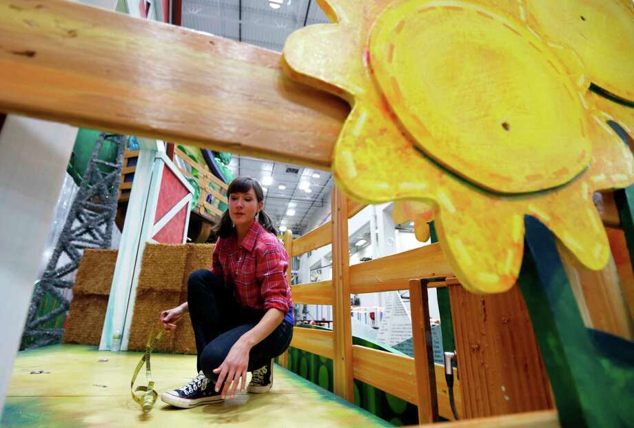 Kelly Vrooman, of the Chica Show on the Sprout television network, measures her standing area on a float which will be part of the Macy's Thanksgiving Day Parade, Tuesday, Nov. 13, 2012, in Moonachie, N.J. Photo: Julio Cortez, AP / AP