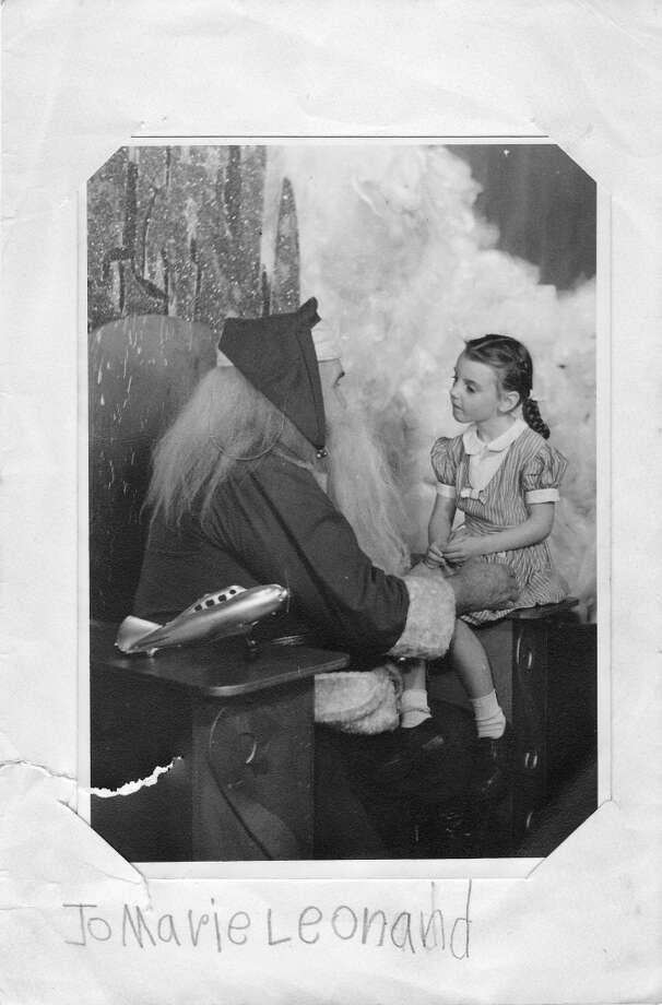 Jo Marie Leonard, 6, poses with Santa Claus at Joske's Toyland at Christmastime 1946. (COURTESY PHOTO)