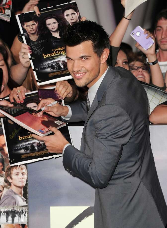 Actor Taylor Lautner arrives at the premiere of Summit Entertainment's 'The Twilight Saga: Breaking Dawn - Part 2' at Nokia Theatre L.A. Live on November 12, 2012 in Los Angeles, California.  (Photo by Jason Merritt/Getty Images) Photo: Jason Merritt, Getty Images / 2012 Getty Images