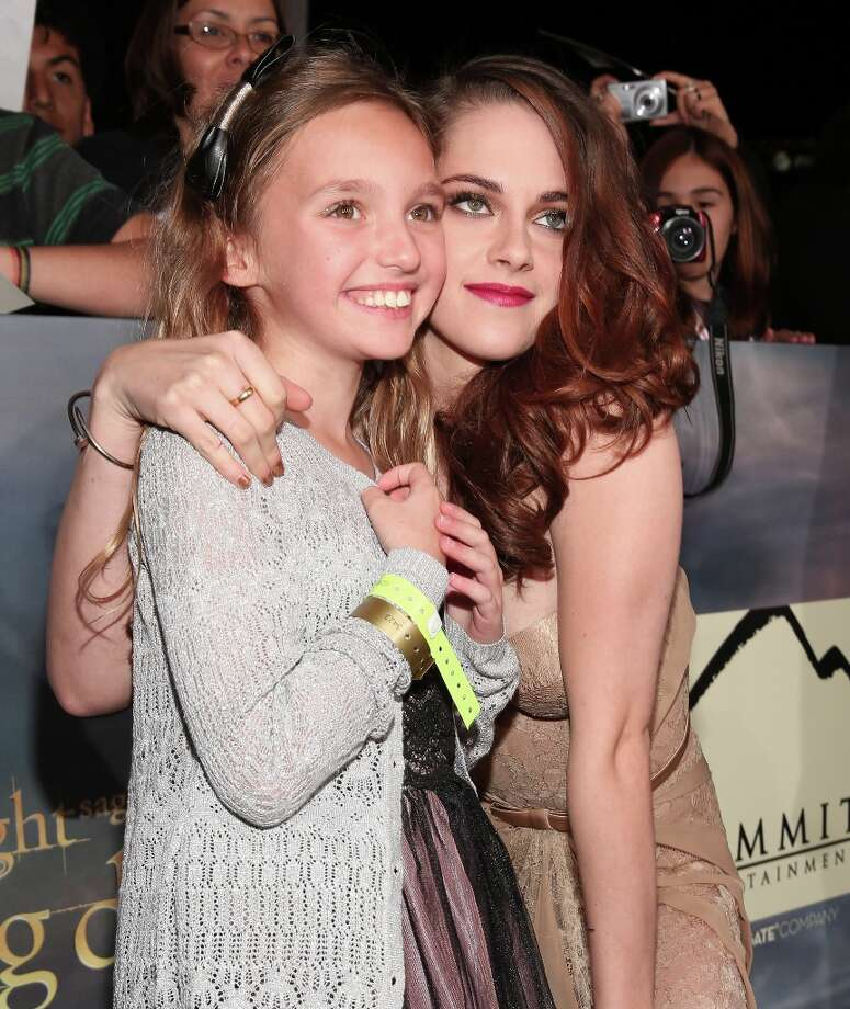 "Actress Kristen Stewart (R) arrives at the premiere of Summit Entertainment's ""The Twilight Saga: Breaking Dawn - Part 2"" at Nokia Theatre L.A. Live on November 12, 2012 in Los Angeles, California.  (Photo by Christopher Polk/Getty Images) Photo: Christopher Polk, Getty Images / 2012 Getty Images"