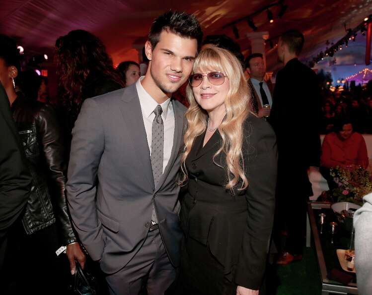 Actor Taylor Lautner (L) and musician Stevie Nicks attend the premiere of Summit Entertainment's&quo