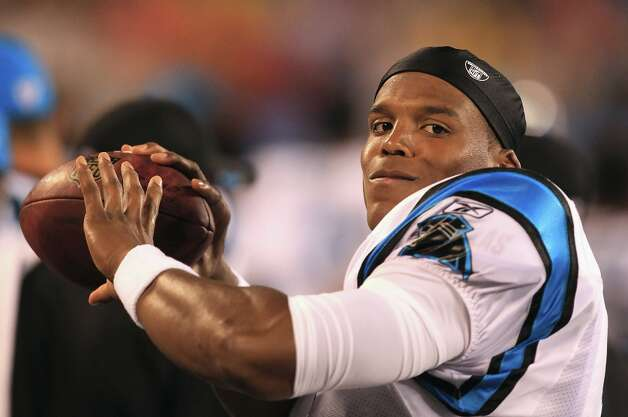 7. Cam Newton | Carolina Panthers, 2011 | passer rating: 84.5When you think of huge rookie seasons – at least those within recent memory – odds are Cam Newton's first year comes to mind. Last season, after being the first overall draft pick, he threw 21 touchdowns and 17 interceptions on his way to being named the NFL's Offensive Rookie of the Year. He led the Panthers to a 6-10 season in 2011, but completed 60.0 percent of his passes and finished with an 84.5 passer rating. Newton isn't doing quite as well this year, though. Photo: Streeter Lecka, Getty Images / 2011 Getty Images