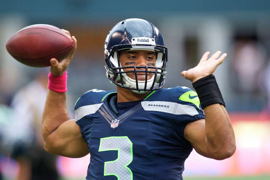 4. Russell Wilson | Seattle Seahawks, 2012 | passer rating: 90.5—through 10 games so far this season —And here we come to Russell Wilson. After 10 games this season so far, Wilson's overall passer rating of 90.5 lands him in the No. 4 spot of this list. Though he has performed much better at home than on the road, Wilson has led the Seahawks to a 6-4 record through this past Sunday. He has thrown 15 touchdowns to eight interceptions -- all of the INTs on the road -- and is completing 62.1 percent of his passing attempts so far. Wilson may have a passer rating of just 65.8 on the road, but his rating at CenturyLink Field is a stunning 122.0. Even as a rookie, there aren't many NFL quarterbacks who have been as good as Wilson at home. Photo: Stephen Brashear, Getty Images / 2012 Getty Images