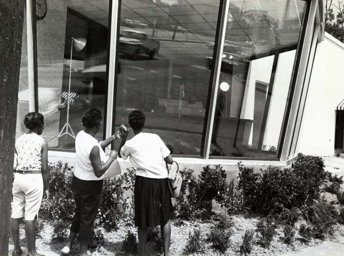 From the Aug. 26, 1963, Houston Post: Passers-by take a look at studio. KCOH has planned many merchandising promotions to make sales use of their Looking Glass Studio. People passing and other listeners will be invited in to enjoy products advertised on radio KCOH and watch and listen to the program in progress. (Houston Post)