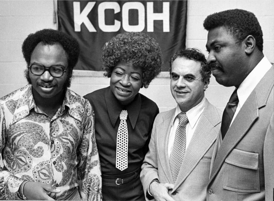 KCOH executives pose with one of their star DJs. From left, program director Paris Eley, disc jockey Gladys 'Gee Gee' Hill, general manager Mike Petrizzo and operations manager Travis Gardner. (Houston Chronicle)