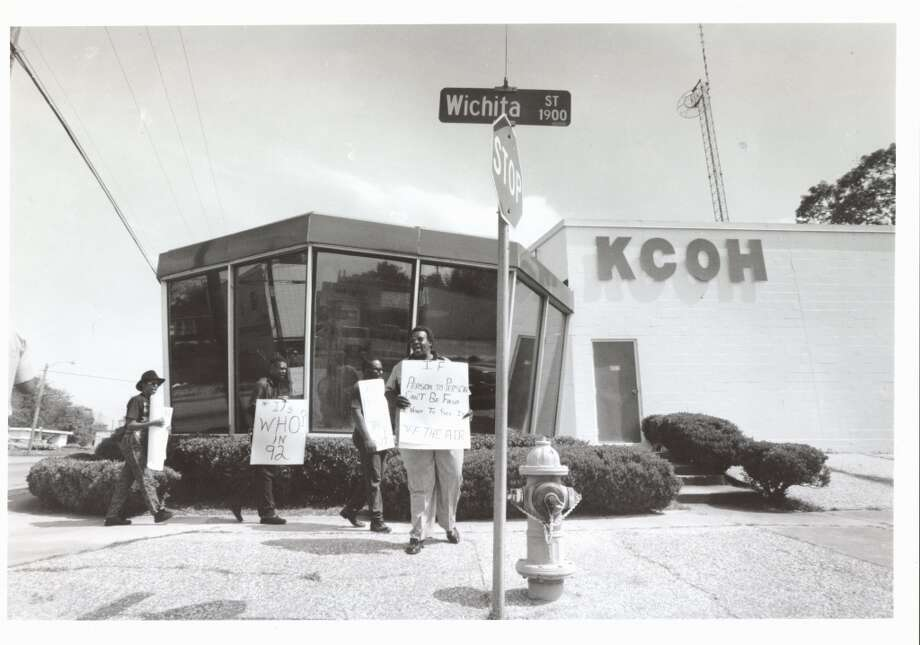 Demonstrators picket outside KCOH for alleged unfairness toward alternative viewpoints, March 27, 1992. (Houston Chronicle)