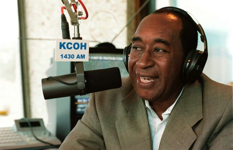 Wash Allen visits with listeners during his radio show at KCOH studios on Sept. 13, 2001. (Houston Chronicle)