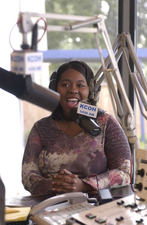 """Studio guest Tina Epson talks with """"Person-to-Person"""" host Michael Harris at KCOH. (Houston Chronicle)"""