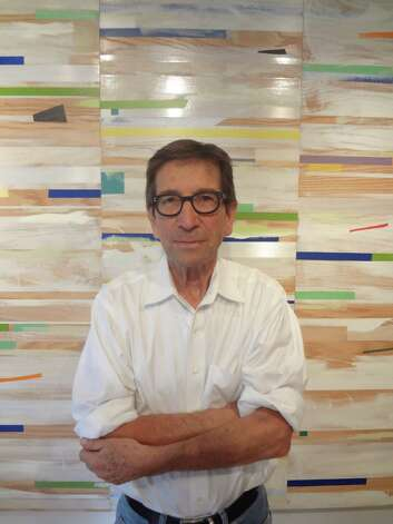 "San Antonio architect and artist Richard Mogas uses all kinds of tape in his ""landscapes,"" including ""Landscape Grid"" behind him, now on view at REM Gallery. Photo: Steve Bennett, San Antonio Express-News"