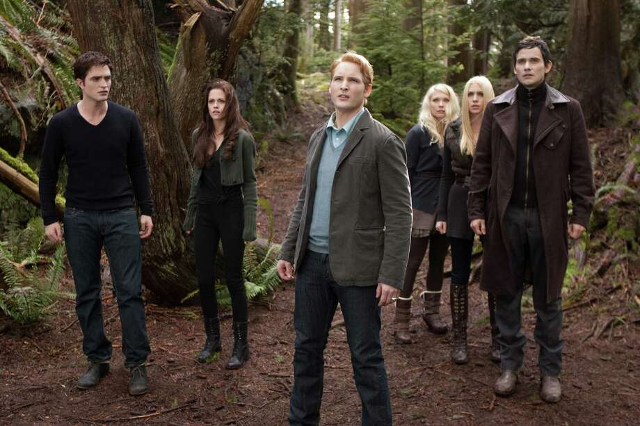 "Robert Pattinson (from  left), Kristen Stewart, Peter Facinelli, MyAnna Buring, Casey LaBow and Christian Camargo look alert and stylish in ""The Twilight Saga: Breaking Dawn — Part 2,"" a movie that only true fans could love.  Photo: Summit Entertainment / Summit Entertainment"