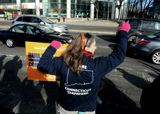 Nancy Hearn of Local 230 union protests against Baker Concrete at the intersection of Washington Blvd. and Tresser Blvd. on Wednesday, November 14, 2012. Photo: Lindsay Niegelberg / Stamford Advocate