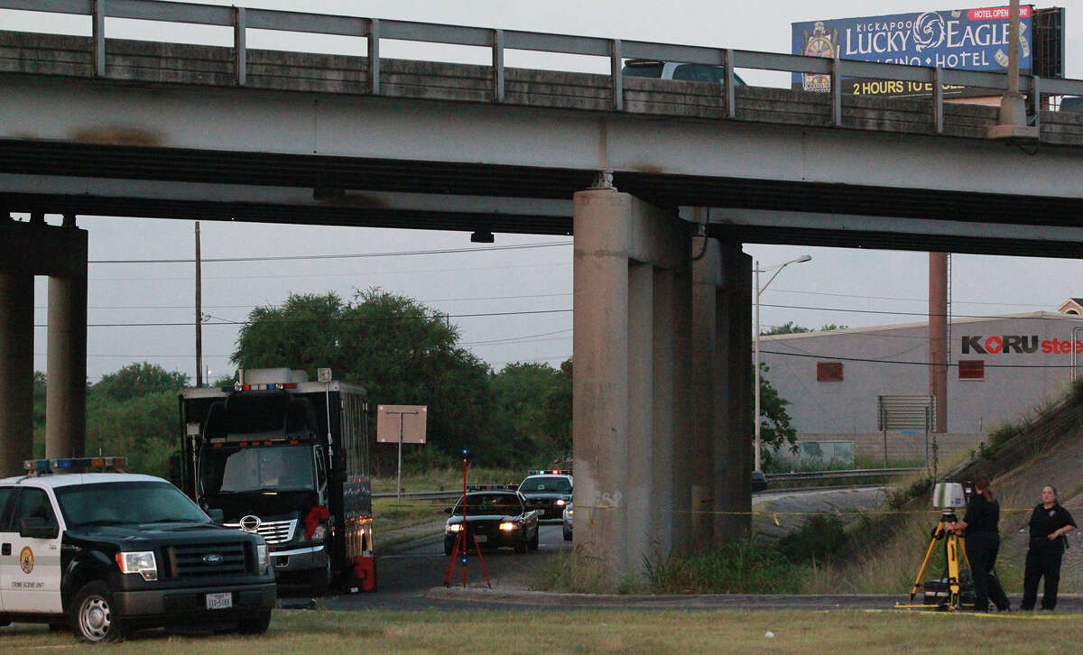 San Antonio police investigate Thursday July 11, 2013 under Interstate highway 35 near the AT&T Parkway exit where the body of a man was found early in the morning in a turnaround lane. Police say the man had been shot and there was a trail of blood on the southbound feeder road. The incident is still being investigated.