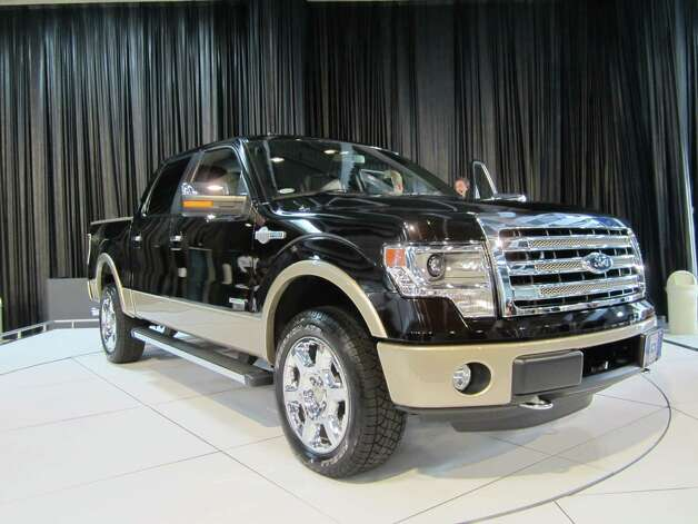 A 2013 Ford F-150 Kind Ranch truck is seen on Thursday, Sept. 27 at the State Fair of Texas auto show in Dallas. The Ford Motor Co. and Kingsville ranch have partnered since 2000 to release special editions of Ford's F-Series. Photo: Neal Morton, Wire Photos / © 2012 San Antonio Express-News