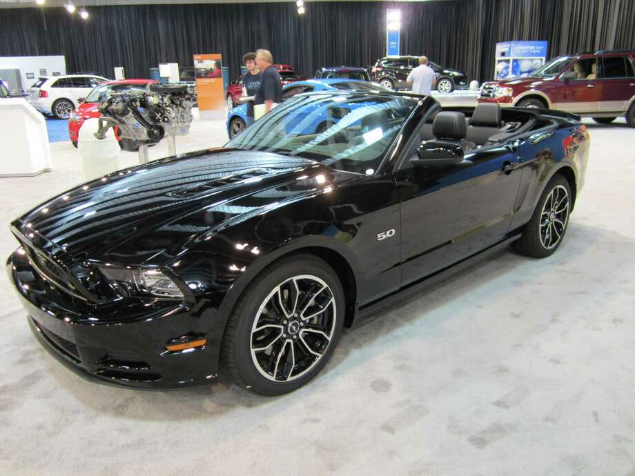 A 2013 Ford Mustang GT 5.0 convertible is seen on Thursday, Sept. 27 at the State Fair of Texas auto show in Dallas. The vehicle was unveiled in late 2011. Photo: Neal Morton, Wire Photos / © 2012 San Antonio Express-News