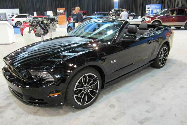 A 2013 Ford Mustang GT 5.0 convertible is seen on Thursday, Sept. 27 at the State Fair of Texas auto show in Dallas. The vehicle was unveiled in late 2011.