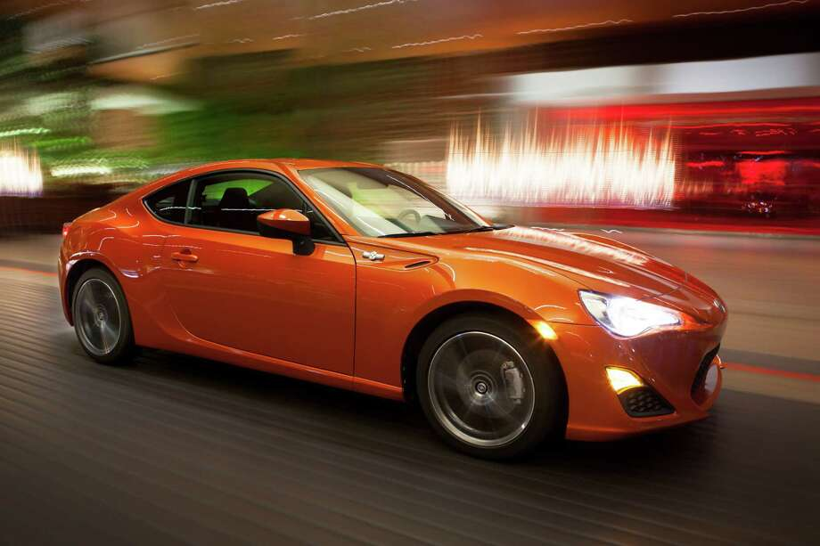 Toyota's return to the affordable-performance realm has arrived in the form of the all-new, rear-wheel-drive 2013 Scion FR-S sports car. Prices begin at $24,200 (plus $785 freight) for the six-speed manual model, and $25,300 for the version equipped with a six-speed automatic. It's a product of Toyota's alliance with and ownership interest in the smaller Japanese automaker Subaru. Under the hood is a normally aspirated 200-horsepower 2.0-liter boxer-style flat four-cylinder engine that was created using Subaru and Toyota technology. All models have the front-engine/rear-drive configuration. EPA ratings are 25 mpg city/34 highway/28 combined with the automatic transmission, and 22/30/25 for the manual. Photo: Handout, Wire Photos / MCT
