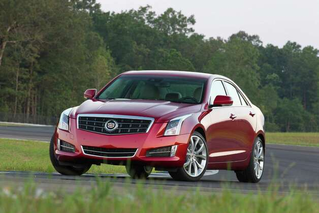 2013 Cadillac ATS Sedan Cadillac's all-new compact entry-level sport sedan, the ATS, has arrived for 2013, posed as a direct challenge to the latest generation of BMW's similarly sized 3-series sedans. Clearly aimed at a younger and more sport- and technologically oriented customer than the midsize CTS sedan, the ATS begins at $33,090 (plus $895 freight) for the base 202-horsepower 2.5-liter four-cylinder model. It ranges as high as $47,795 for the 321-horsepower Premium 3.6-liter V-6 with all-wheel drive. In between are 14 other trim levels, including 272-horsepower turbocharged 2.0-liter four-cylinder versions that start at $34,900, and come with a six-speed manual gearbox. A six-speed automatic is the only choice on the 2.5- and 3.6-liter models, and it's also available with the turbo engine. The ATS is about nine inches shorter than the CTS sedan, with a wheelbase that's four inches shorter. Photo: Richard Prince, Wire Photos / Cadillac