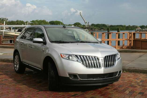 The 2013 Lincoln MKX midsize crossover, redesigned last year, begins under $40,000 for the front-wheel-drive model and under $42,000 for the all-wheel-drive. It's a car-based family utility vehicle built on the same architecture as the Ford Edge, but with more standard luxury features. 
