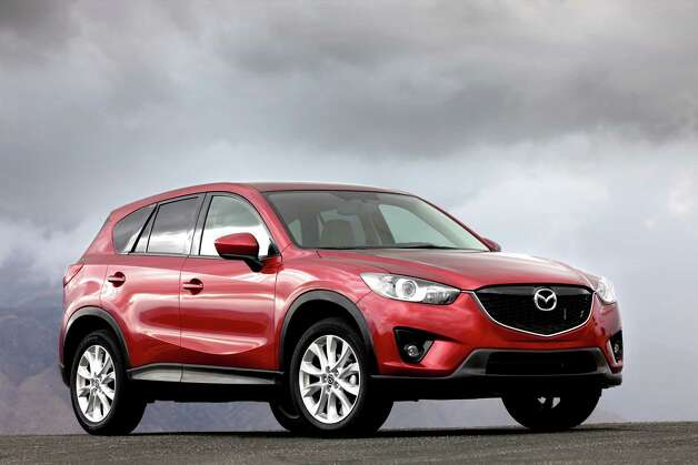 2013 Mazda CX-5 Brand new for 2013 is the compact CX-5 crossover, with seating for five, and based on a Mazda design. It replaces the CX-7, which was essentially a Ford design. Under the hood is Mazda's new Skyactiv 155-horsepower 2.0-liter four-cylinder engine, designed to provide fuel economy and performance without sacrificing on either. Prices begin at $20,695 (plus $795 freight) for the base front-wheel-drive Sport model with a six-speed manual transmission, or $22,045 with a six-speed automatic. The Sport automatic with all-wheel drive is $23,345. The Sport is the only trim available with the manual, which gets 35 mpg on the highway. 