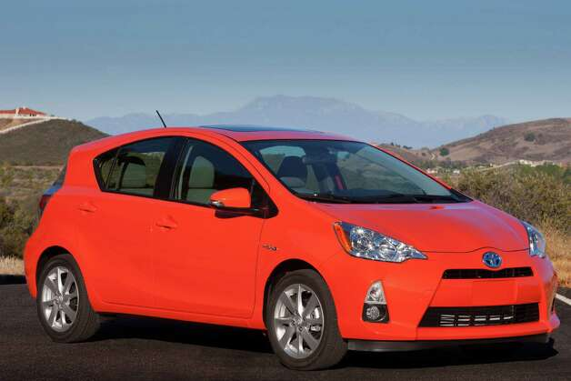 The 2013 Toyota Prius C is the fourth model in the newly expanded Prius lineup and the least expensive Toyota hybrid. Its fuel economy is even better than that of the groundbreaking Prius compact hatchback. It's roomy (for its size) and fun to drive, while offering a host of standard and optional amenities. Photo: Wire Photos / Dewhurst Photography