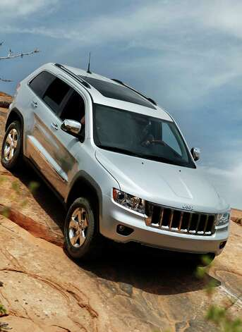The 2013 Jeep Grand Cherokee is a well-designed family SUV that can hold its own with the best of the crossover genre or pull away from that pack when asked to perform in the most rugged off-road situations. Photo: Bill Delaney, Wire Photos