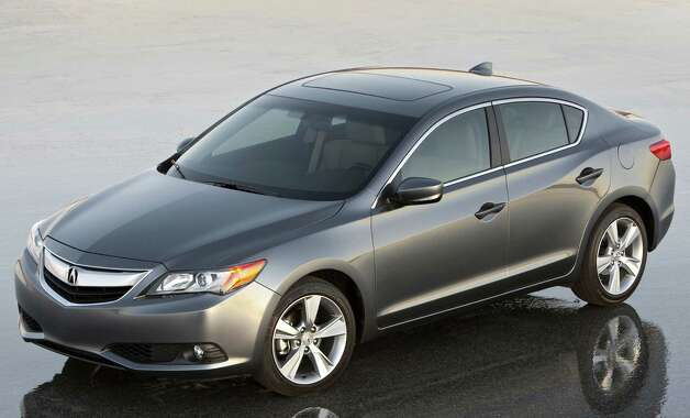 The Acura ILX, based on the chassis of the Honda Civic, comes with a choice of three drivetrains and six trim levels, starting at $25,900. Outside, the ILX is wide and low with a long nose and a short tail, strong body-side character lines and an aerodynamically sculpted cabin, for a sporty, windswept look. Photo: Wire Photos