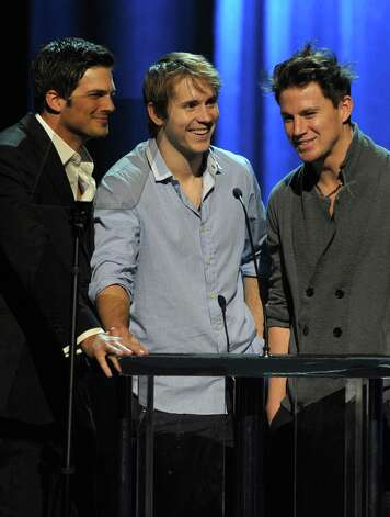 HOLLYWOOD - NOVEMBER 29:  (L-R) Jonathan Roberts, Robert Hoffman and actor Channing Tatum speak onstage at the Dizzy Feet Foundation's Inaugural Celebration of Dance at The Kodak Theater on November 29, 2009 in Hollywood, California. Photo: Kevin Winter, Getty Images For Dizzy Feet Foun / 2009 Getty Images