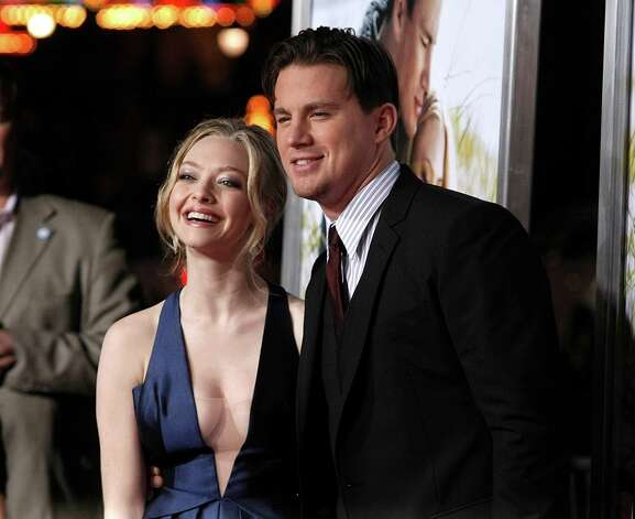 "FILE - In this Feb. 1, 2010 file photo, Actress Amanda Seyfried and Channing Tatum arrive at the premiere of the feature film ""Dear John"" in Los Angeles. The science-fiction love story has given way to an earthbound romance at the weekend box office. ""Dear John"" debuted as the No. 1 movie with $32.4 million, knocking off the blockbuster ""Avatar"" after seven weekends in first place. Photo: DAN STEINBERG, AP / R-STEINBERG"
