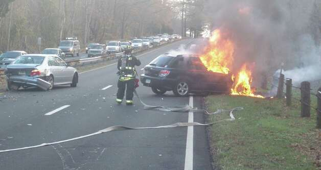 A multi-vehicle crash and car fire on the Merritt Parkway Wednesday morning was caused after several drivers said they hit a coyote that wandered onto the highway.   Westport CT 11/14/ 12 Photo: Westport Fire Department / Westport News contributed