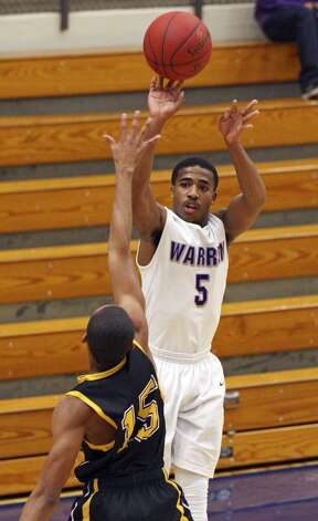 Marcus Keene, Warren: Youngstown StateWarren's Marcus Keene shoots over Brennan's Dave Holdipp during first half action Monday Nov. 12, 2012 at Paul Taylor Field House. (San Antonio Express-News)