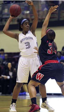 Aleeya Harris, Jay: Western KentuckyMustang post Aleeya Harris works the ball up high against Ashley Dunn as Wagner defeats Jay in girls playoff basketball action at Littleton Gym on February 17, 2012 Tom Reel/ San Antonio Express-News (San Antonio Express-News)