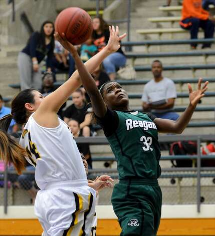 Moriah Mack, Reagan: New Mexico StateReagan's Moriah Mack (32) takes a shot past Brennan's Eliza Martinez (44) during a girls non-district basketball game between the Brennan Bears and the Reagan Rattlers at Paul Taylor Field House in San Antonio, Saturday, November 5, 2012.John Albright / Special to the Express-News. (San Antonio Express-News)