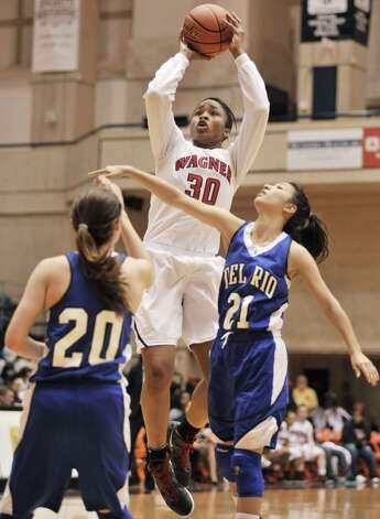 Tesha Smith, Wagner:  UTSAWagner's Tesha Smith (30) shoots over De Rio's Aneya Torres (21) and Kelsey Green during the first half of a girls' high school basketball playoff game, Friday, Feb. 24, 2012, at UTSA in San Antonio. Wagner won 58-46. (Darren Abate/Special to the Express-News) (SPECIAL TO THE EXPRESS-NEWS)