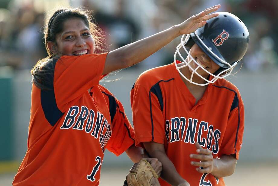 Anna Parnin, Brandeis: Texas A&M InternationalAfter scoring the first run, Melissa Rodriguez gets a slap on the helmet from Anna Parnin as Brandeis beats Southwest 6-4 in playoff action at Southwest High School on April 26, 2012. Tom Reel/ San Antonio EXpress-News (San Antonio Express-News)