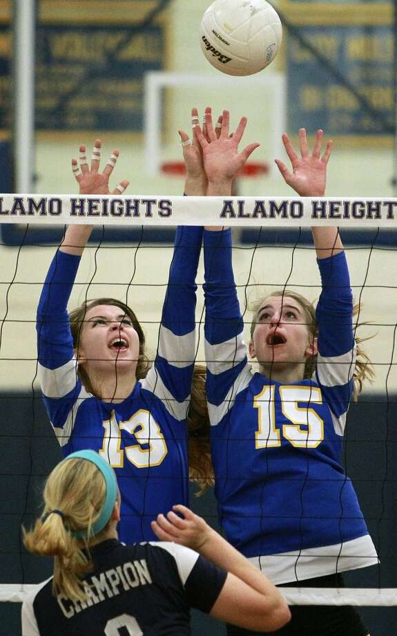 Sloan Evans, Alamo Heights: Appalachian State (N.C.)Lady Mules Sloan Evans (13)  and McKay Kyle go after a tip by Claire Kreuz as Champion beats Alamo Heights 3-0 in volleyball at Alamo Heights gym  on October 23, 2012. (San Antonio Express-News)