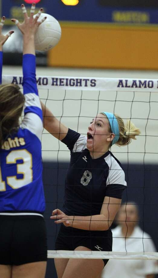 Claire Kreuz, Boerne Champion: North Carolina-CharlotteClaire Kreuz slams a shot into Sloan Evans for the Chargers  as Champion beats Alamo Heights 3-0 in volleyball at Alamo Heights gym  on October 23, 2012. (San Antonio Express-News)