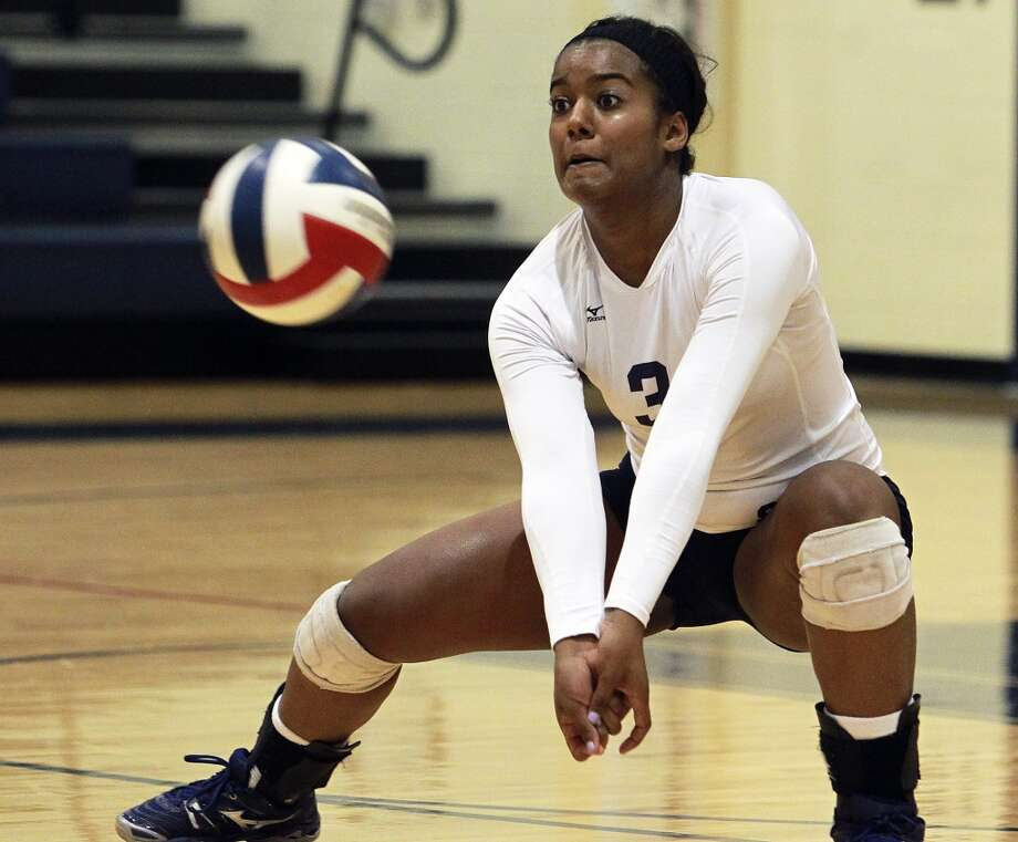 Nina Mody-Bailey, Smithson Valley: Adams State (Colo.) — signing Tuesday (Nov. 20)The Ranger's Nina Mody-Bailey grabs a serve as Churchill beats Smithson Valley 3-0 at Smithson Valley gym  on August 28, 2012. (San Antonio Express-News)
