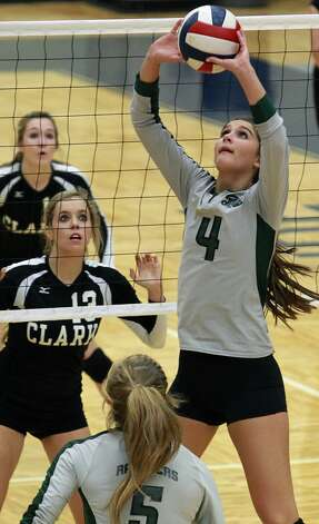 Morgan Reed, Reagan: BaylorMorgan Reed sets for the Rattlers as Reagan defeats Clark 3-0 in 5A second round volleyball playoff action at TAylor Field House on November 1, 2012. (San Antonio Express-News)
