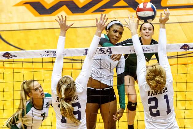 Bailey Shurbet, Reagan: Kansas StateReagan's Tarine Grace (center) gets a shot past Smithson Valley's McKinlee Boss (right) and Allison Meckel as Katie Medell (top right) and Bailey Shurbet look on during the first set of their Class 5A third round volleyball match at the UTSA Convocation Center on Nov. 6, 2012.  Smithson Valley won the match in three straight sets: 25-23, 25-21 and 25-19.  MARVIN PFEIFFER/ mpfeiffer@express-news.net (Marvin Pfeiffer/ Express-News)