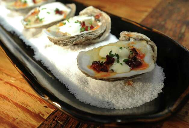 Local gulf oyster with Spanish-style chorizo and cave-aged white cheddar. Hyatt Hill Country, March 11, 2010. BILLY CALZADA / gcalzada@express-news.net
