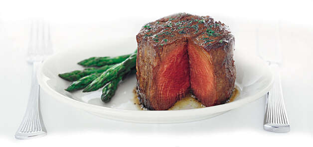 Ruth's Chris Steak House, 7720 Jones Maltsberger Road, 210-821-5051, is open 11 a.m.-9 p.m., and 1170 E. Commerce St., 210-227-8847, is open 4-9 p.m. with its regular menu. Photo: Express-News/File Photo