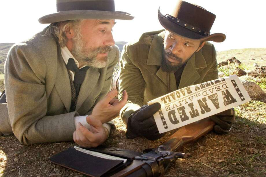 CHRISTOPH WALTZ and JAMIE FOXX star in DJANGO UNCHAINED Photo: TWC